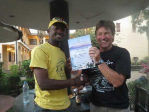 Mt Meru – ZTA guide Frankie presents Certificate to climber